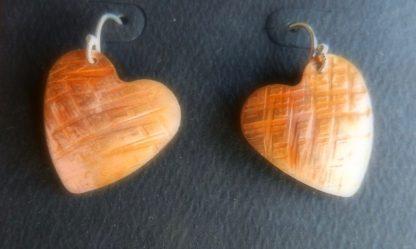 Cross Hatch Heart earrings in bare copper hung on Sterling ear wires
